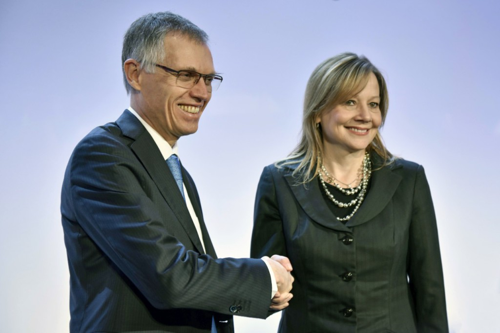 Change of ownership at Opel/Vauxhall: PSA Group CEO, Carlos Tavares and GM CEO, Mary Barra at the press conference in Paris.